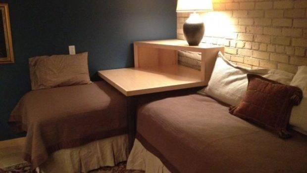 Corner Table Converts Two Twin Beds Into Sleeping Lounging