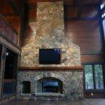 Cream Fieldstone Fireplace Feat Brown Wood Mantel Lcd Also Some