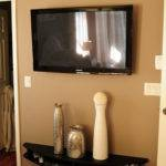 Curved Black Wall Mounted Media Console Shelf Under Flat