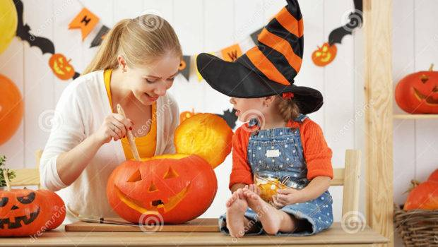 Daughter Preparing Halloween Decorate House