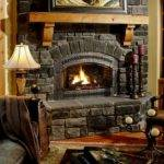 Elegant Stone Fireplace Inserted Glass Wall
