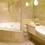 Feature Marble Bathroom Corner Spa Queen Sized Bed Small