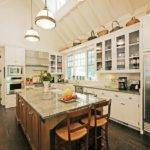 Frame High Ceiling Skylight Rustic Wood Floors White Cabinets