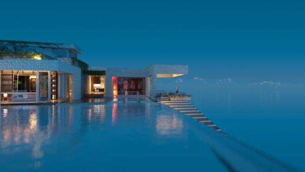 Infinity Pool Practically Spills Out Into Surrounding Beach