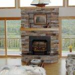 Interesting Dry Stack Stone Fireplace Shelf Under Square Painting