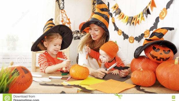 Mother Children Decorate Home Halloween