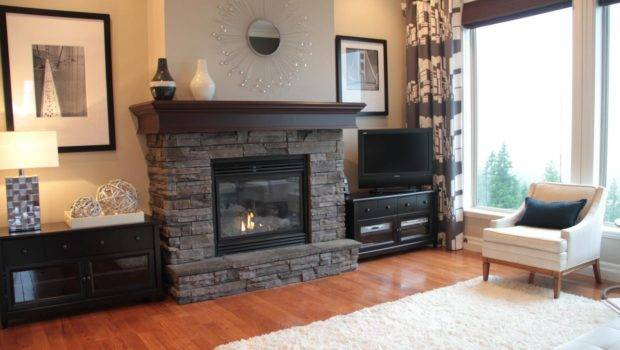 Neutral Living Room Gray Stacked Stone Fireplace