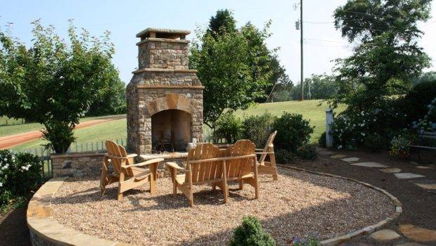 Outdoor Seating Area Stone Fireplace Pebble Ground Cover