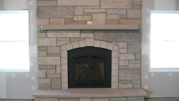 Simple Stone Gas Fireplace Cut Limestone Accents
