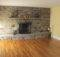 Stone Fireplace Facing Wall