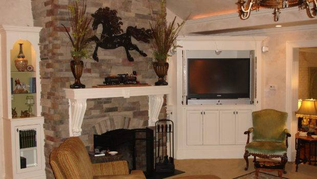 Stone Fireplace Flanked Custom Made Corner Moire Bookcases