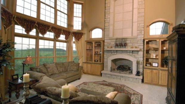 Stone Fireplace Two Story Bay Wall