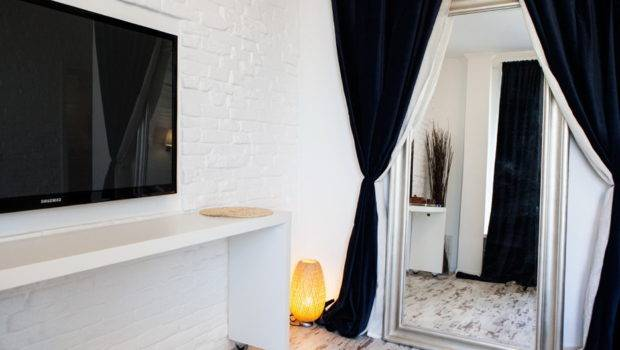 White Walled Apartment Black Curtains Blue Accents Partially