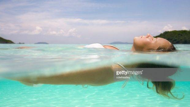 Woman Floating Crystal Clear Water Caribbean