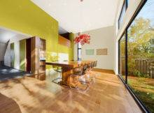 Wood Dining Table Against Lime Green Wall